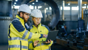 Engineers discuss project on jobsite